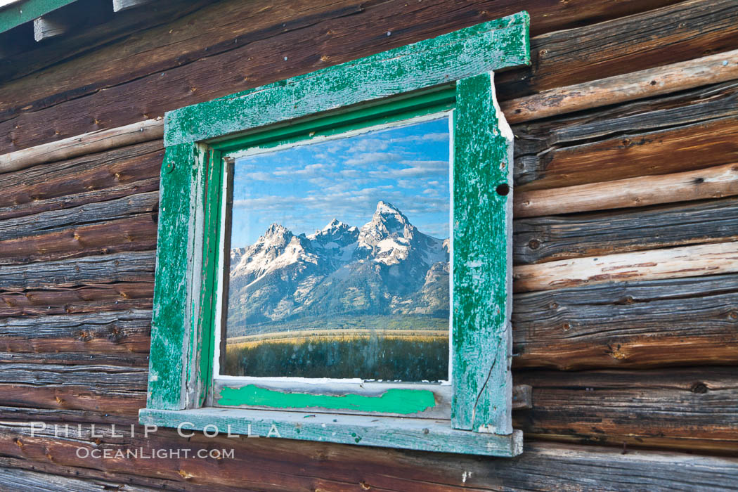 Teton Range reflection, in window of old barn in Grand Teton National Park. Wyoming, USA, natural history stock photograph, photo id 26928