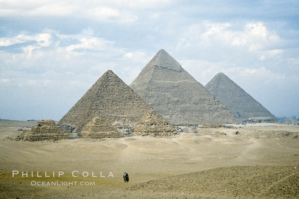 Image 02573, Great pyramids, Giza, Egypt.  Pyramids of Queens, Pyramid of Menkaure, Pyramid of Khafre, Pyramid of Khufu (left to right, front to back)., Phillip Colla, all rights reserved worldwide. Keywords: africa, ancient, cairo, desert, egypt, egyptian pyramid, giza, great pyramid, great pyramids, history, north africa, pyramid, pyramids.