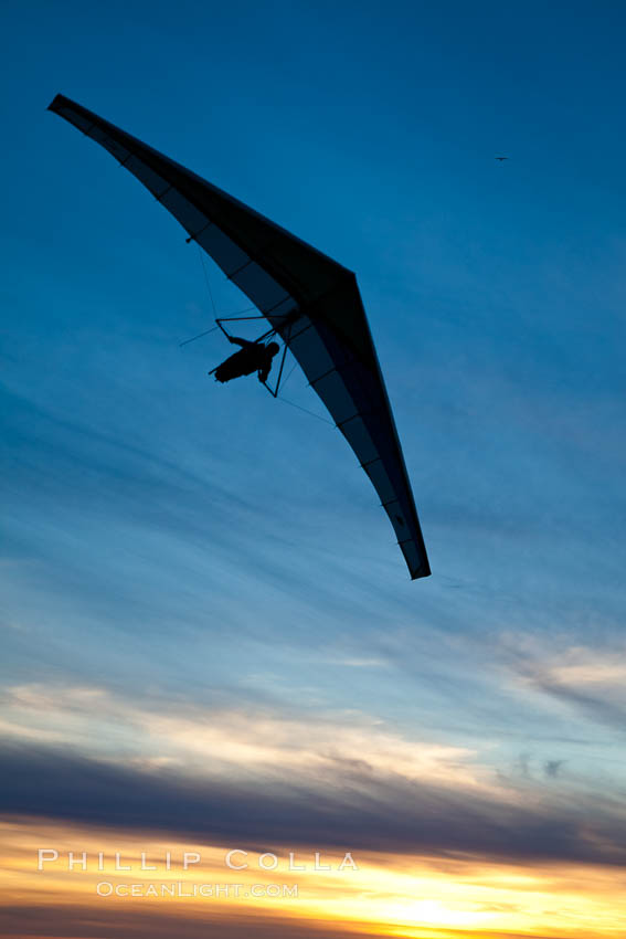 Hang Glider soaring at Torrey Pines Gliderport, sunset, flying over the Pacific Ocean. La Jolla, California, USA, natural history stock photograph, photo id 24290