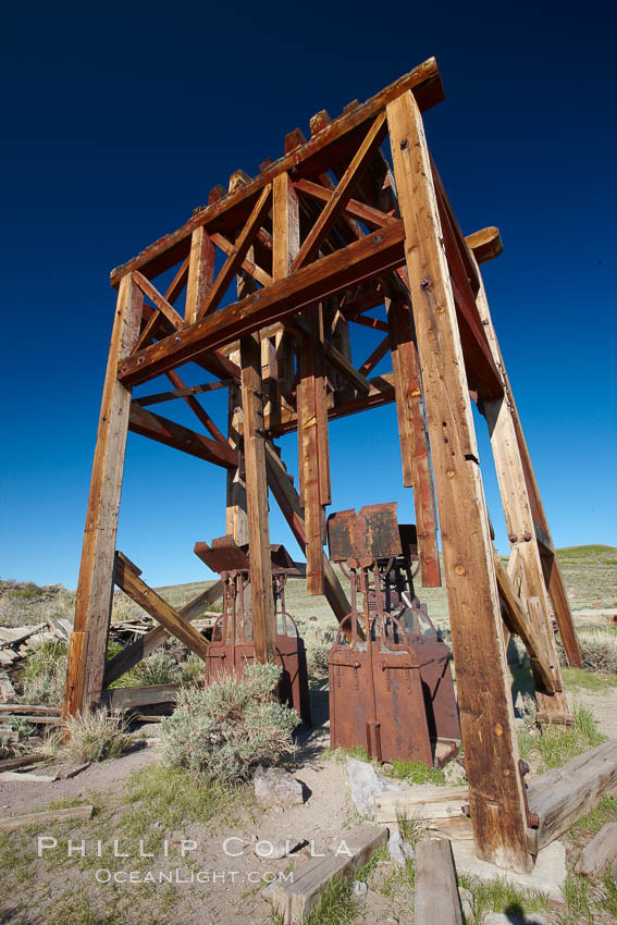 Image 23146, Head frame and machinery. Bodie State Historical Park, California, USA, Phillip Colla, all rights reserved worldwide. Keywords: arrested decay, bodie, bodie ghost town, bodie state historic park, bodie state historical park, bridgeport, california, eastern sierra, ghost town, gold mine, gold mining, gold rush, historic state park, mining camp, mining town, old west, outdoors, outside, sierra, state park, state parks, town, usa, village, west.