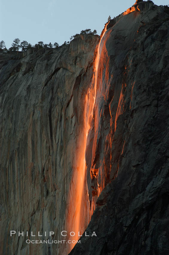 Horsetail Falls backlit by the setting sun as it cascades down the face of El Capitan, February, Yosemite Valley. Yosemite National Park, California, USA, natural history stock photograph, photo id 06996