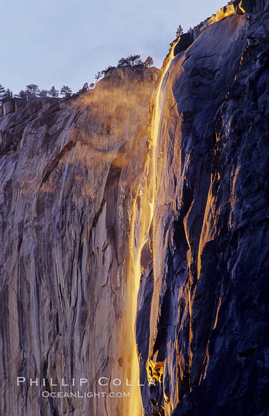 Image 07048, Horsetail Falls backlit by the setting sun as it cascades down the face of El Capitan, February, Yosemite Valley. Horsetail Falls, Yosemite National Park, California, USA