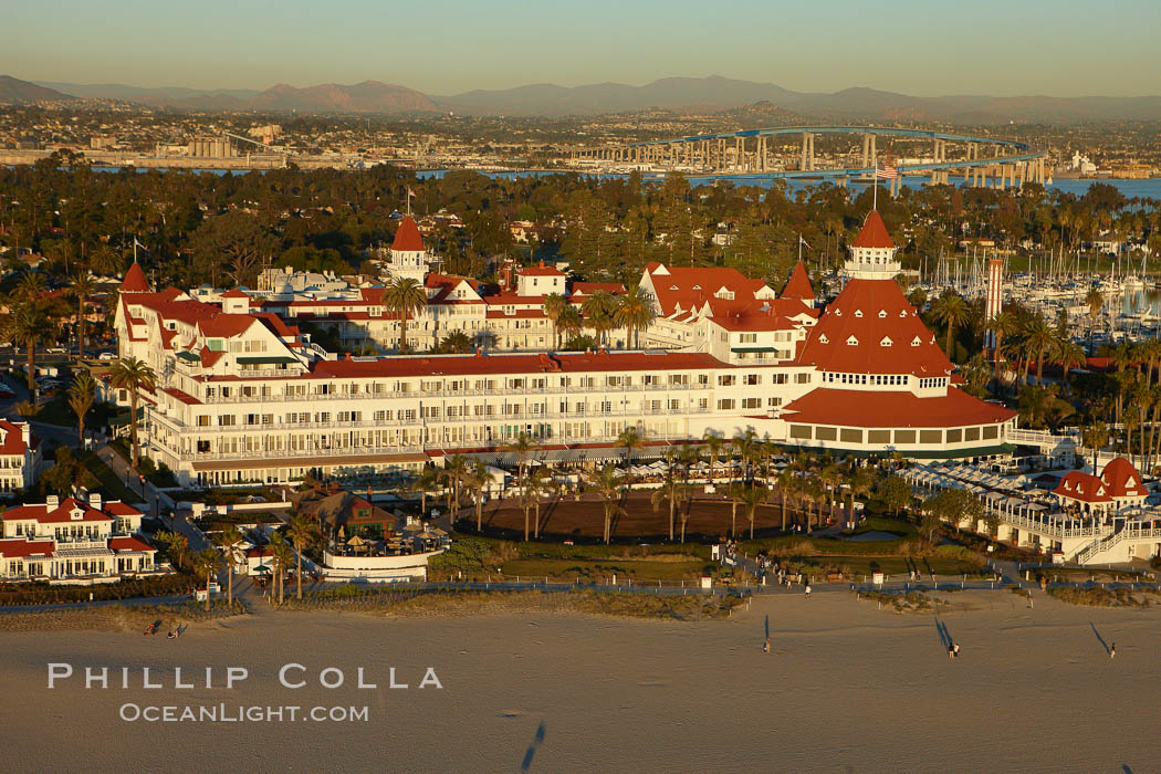 Hotel del Coronado, known affectionately as the Hotel Del.  It was once the largest hotel in the world, and is one of the few remaining wooden Victorian beach resorts.  It sits on the beach on Coronado Island, seen here with downtown San Diego in the distance.  It is widely considered to be one of Americas most beautiful and classic hotels. Built in 1888, it was designated a National Historic Landmark in 1977. San Diego, California, USA, natural history stock photograph, photo id 22334