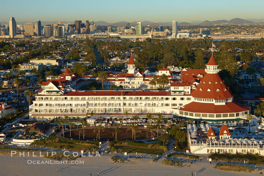 Hotel del Coronado, known affectionately as the Hotel Del.  It was once the largest hotel in the world, and is one of the few remaining wooden Victorian beach resorts.  It sits on the beach on Coronado Island, seen here with downtown San Diego in the distance.  It is widely considered to be one of Americas most beautiful and classic hotels. Built in 1888, it was designated a National Historic Landmark in 1977. California, USA, natural history stock photograph, photo id 22296