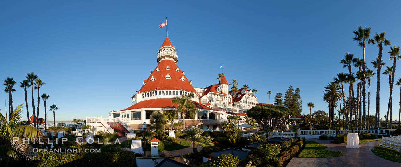 Hotel del Coronado, known affectionately as the Hotel Del. It was once the largest hotel in the world, and is one of the few remaining wooden Victorian beach resorts. It sits on the beach on Coronado Island, seen here with downtown San Diego in the distance. It is widely considered to be one of Americas most beautiful and classic hotels. Built in 1888, it was designated a National Historic Landmark in 1977. California, USA, natural history stock photograph, photo id 27104