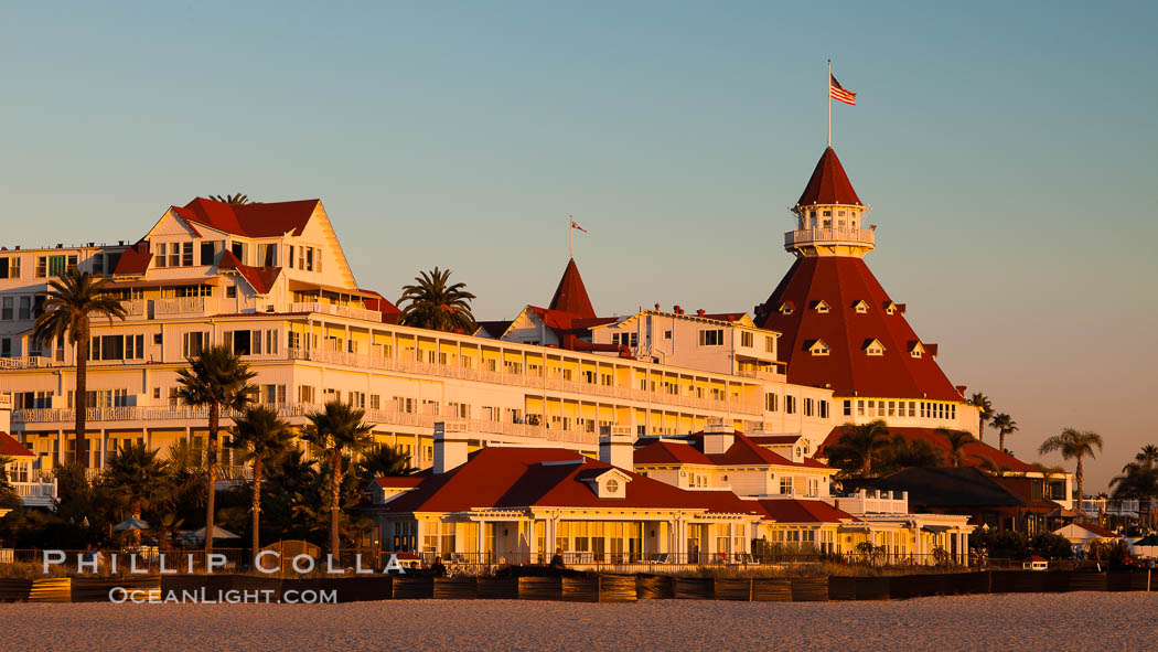 Image 27395, Hotel del Coronado, known affectionately as the Hotel Del. It was once the largest hotel in the world, and is one of the few remaining wooden Victorian beach resorts. It sits on the beach on Coronado Island, seen here with downtown San Diego in the distance. It is widely considered to be one of Americas most beautiful and classic hotels. Built in 1888, it was designated a National Historic Landmark in 1977. San Diego, California, USA, Phillip Colla, all rights reserved worldwide. Keywords: beach, california, city, coast, coronado, coronado island, del, downtown, historic, hotel, hotel del, hotel del coronado, inn, landmark, ocean, outdoors, outside, over, pacific, resort, san diego, scene, scenery, scenic, sea, seashore, shore, tourism, travel, urban, usa, view, vista.