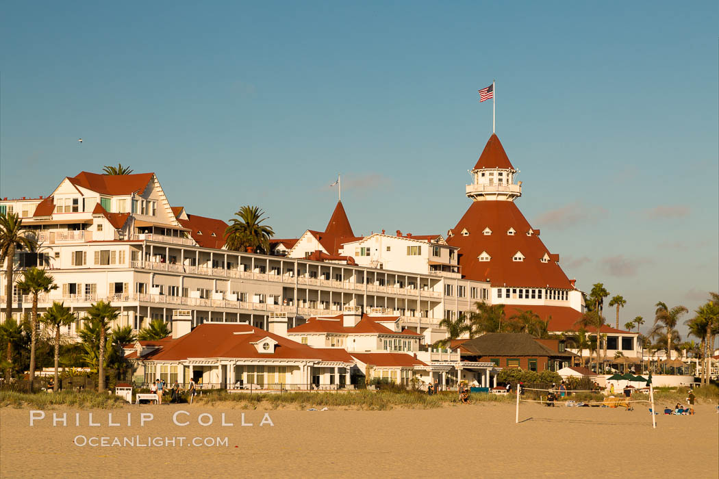 Hotel del Coronado, known affectionately as the Hotel Del. It was once the largest hotel in the world, and is one of the few remaining wooden Victorian beach resorts. It sits on the beach on Coronado Island, seen here with downtown San Diego in the distance. It is widely considered to be one of Americas most beautiful and classic hotels. Built in 1888, it was designated a National Historic Landmark in 1977. San Diego, California, USA, natural history stock photograph, photo id 27887