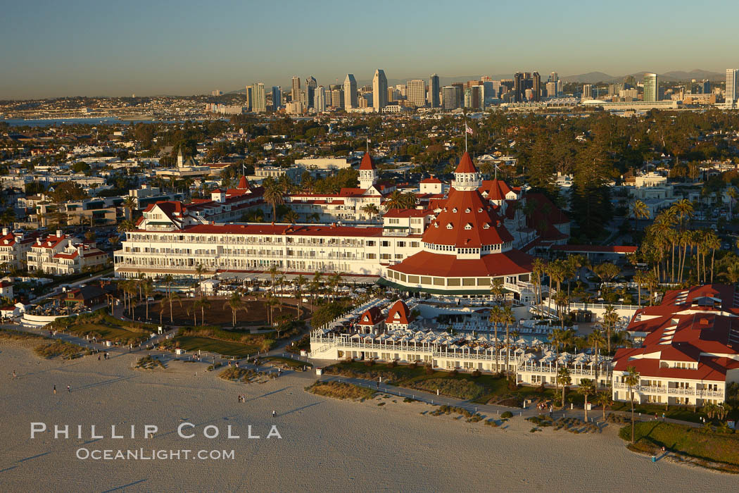 Hotel del Coronado, known affectionately as the Hotel Del.  It was once the largest hotel in the world, and is one of the few remaining wooden Victorian beach resorts.  It sits on the beach on Coronado Island, seen here with downtown San Diego in the distance.  It is widely considered to be one of Americas most beautiful and classic hotels. Built in 1888, it was designated a National Historic Landmark in 1977. San Diego, California, USA, natural history stock photograph, photo id 22353