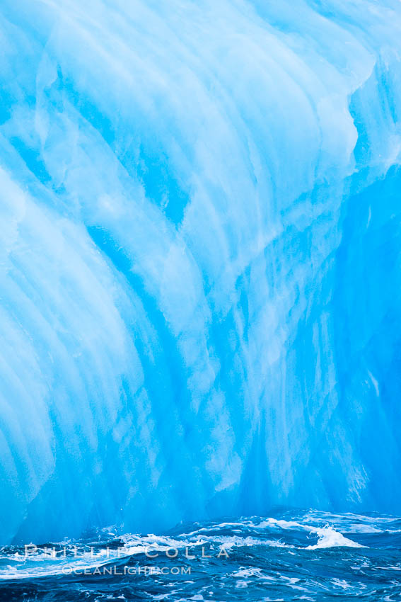 Image 24846, A blue iceberg.  Blue icebergs are blue because the ice from which they are formed has been compressed under such enormous pressure that all gas (bubbles) have been squeezed out, leaving only solid water that takes on a deep blue color. Scotia Sea, Southern Ocean