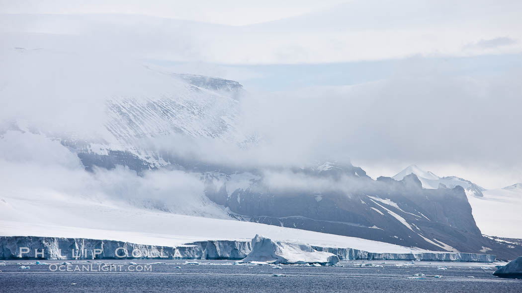 Iceberg and snow-covered coastline, Antarctic Sound. Antarctic Peninsula, Antarctica, natural history stock photograph, photo id 24875