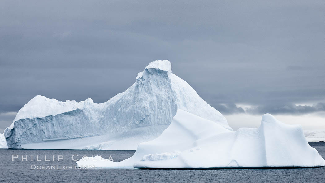 Icebergs in Paradise Bay, sculpted by water and time, Antarctica. Paradise Bay, Antarctic Peninsula, Antarctica, natural history stock photograph, photo id 25658