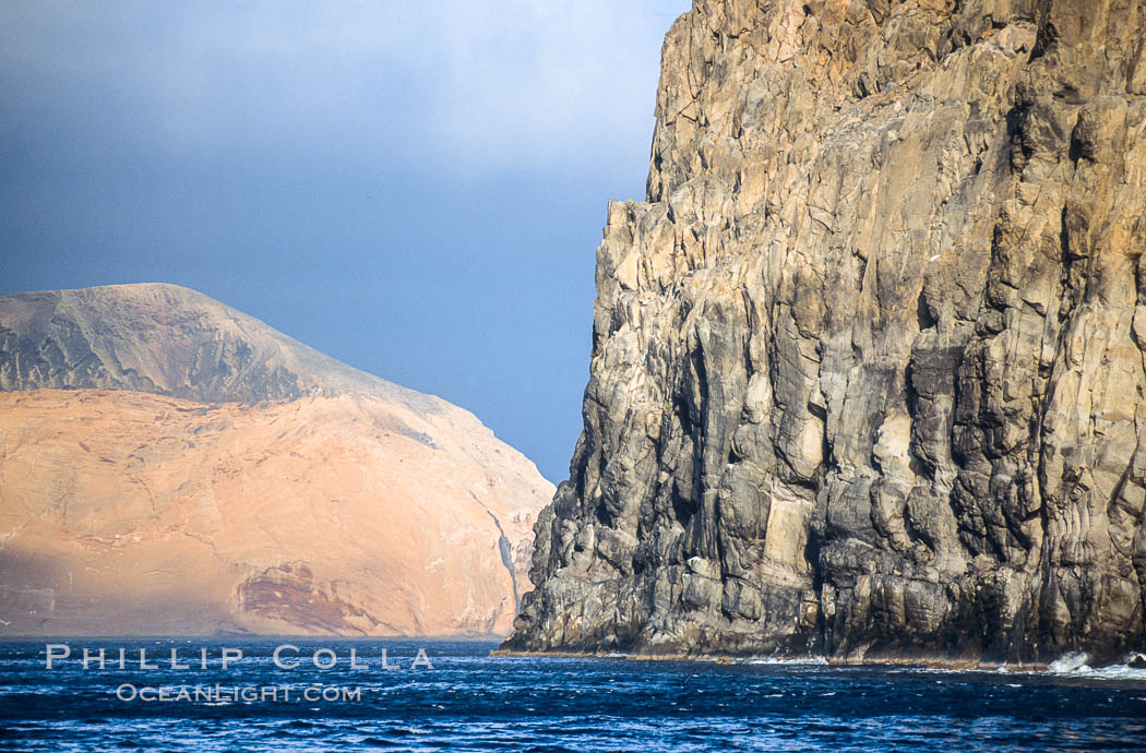 El Moro, a huge volcanic headland at the south end of Guadalupe Island, is seen here partially obscuring the more distant Isla Adentro.  Daybreak. Guadalupe Island (Isla Guadalupe), Baja California, Mexico, natural history stock photograph, photo id 09756