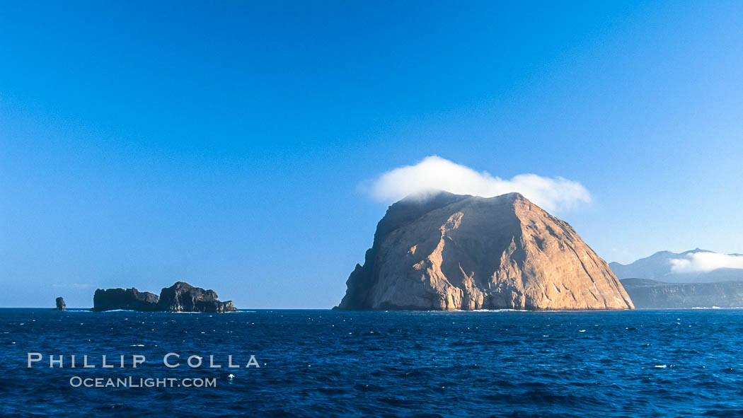 Isla Adentro (right) and Church Rock (partially obscured), sunrise. Guadalupe Island (Isla Guadalupe), Baja California, Mexico, natural history stock photograph, photo id 06141