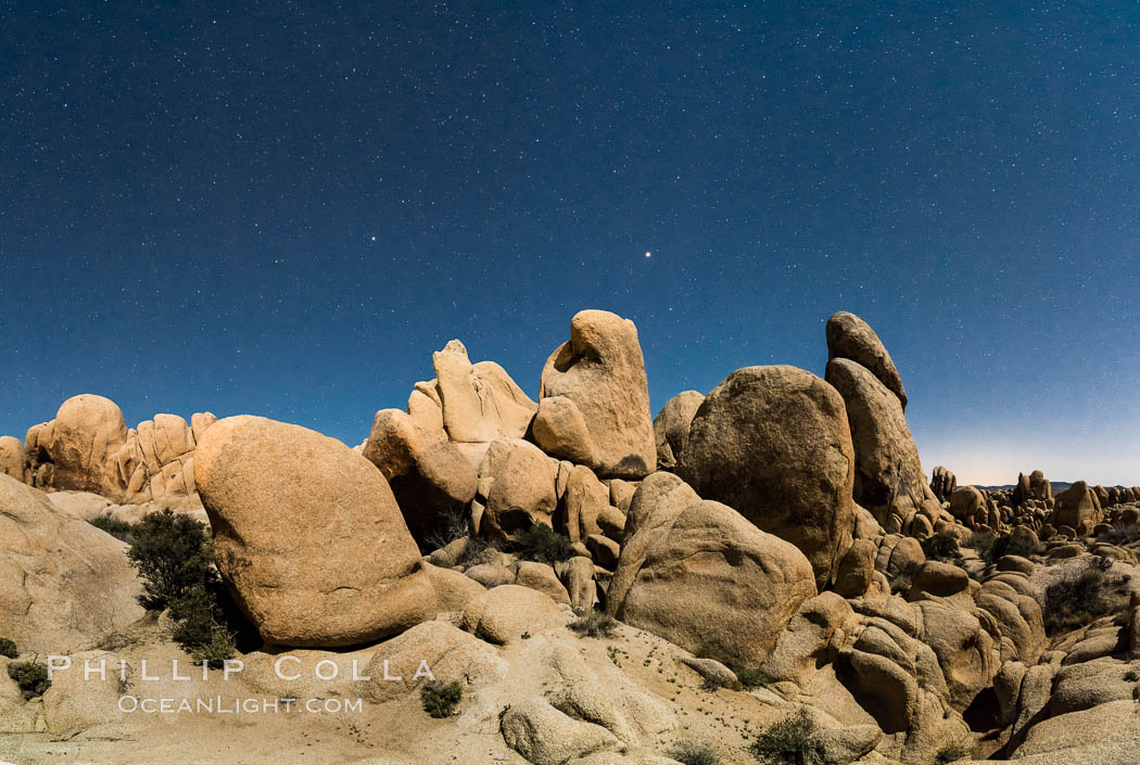 Joshua Tree National Park boulders under a night sky and stars.  Mars is visible in the middle of the image. Joshua Tree National Park, California, USA, natural history stock photograph, photo id 29194