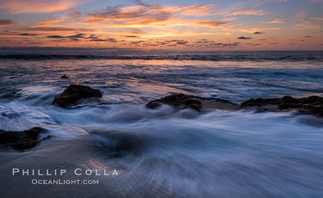 La Jolla coast sunset, waves wash over sandstone reef, clouds and sky. La Jolla, California, USA, natural history stock photograph, photo id 27894