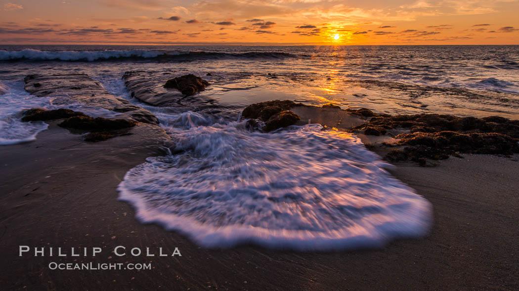 La Jolla coast sunset, waves wash over sandstone reef, clouds and sky. La Jolla, California, USA, natural history stock photograph, photo id 27891