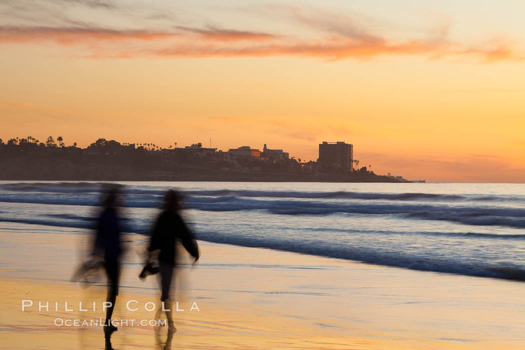 Tourists walk along La Jolla Shores beach at sunset.  Point La Jolla is visible in the distance. Scripps Institution of Oceanography, California, USA, natural history stock photograph, photo id 26533