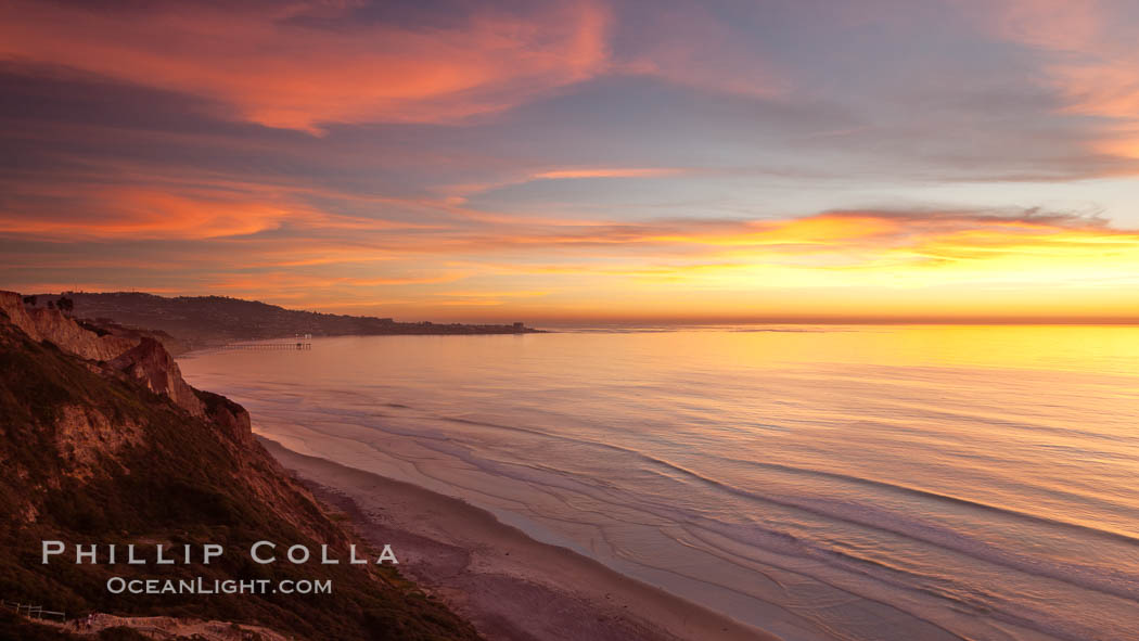 Sunset falls upon Torrey Pines State Reserve, viewed from the Torrey Pines glider port.  La Jolla, Scripps Institution of Oceanography and Scripps Pier are seen in the distance. California, USA, natural history stock photograph, photo id 26439