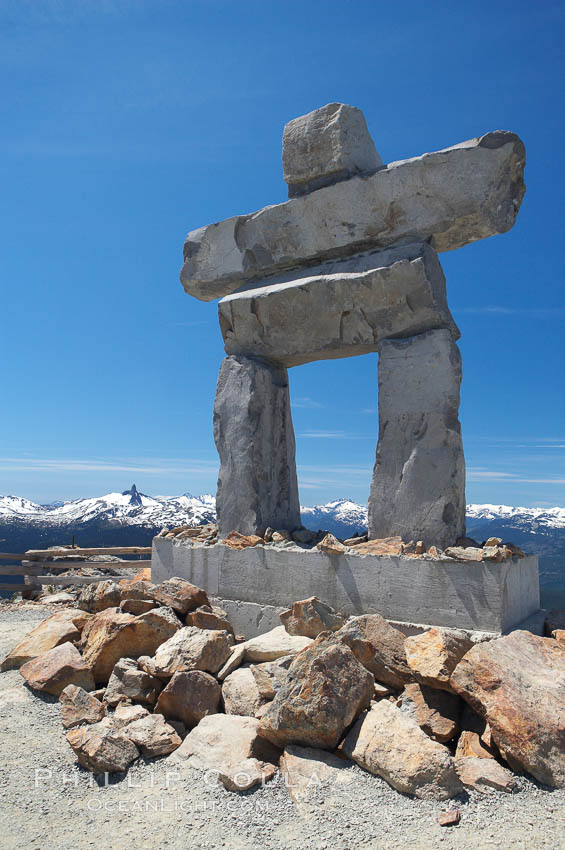 Ilanaaq, the logo of the 2010 Winter Olympics in Vancouver, is formed of stone in the Inukshuk-style of traditional Inuit sculpture.  This one is located on the summit of Whistler Mountain. British Columbia, Canada, natural history stock photograph, photo id 21016