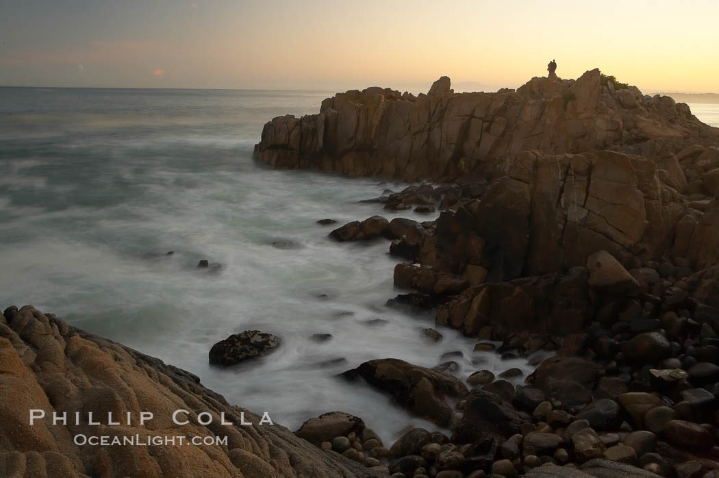 Lovers Point, Pacific Grove.  A couple admires the sunrise atop Lovers Point in Pacific Grove.  Waves breaking over rocks appear as a foggy mist in this time exposure.  Pacific Grove. California, USA, natural history stock photograph, photo id 14918