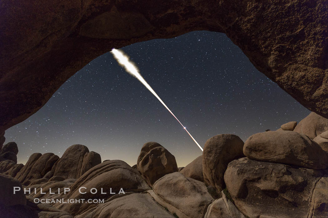 Image 30713, Lunar Eclipse Sequence, the path of the moon through the sky as it progresses from being fully visible (top) to fully eclipsed (middle) to almost fully visible again (bottom), viewed through Arch Rock, April 4 2015. Joshua Tree National Park, California, USA