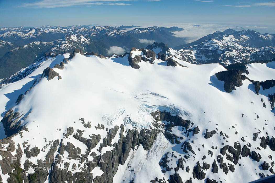 Mariner Mountain, on the west coast of Vancouver Island, British Columbia, Canada, part of Strathcona Provincial Park, located 36 km (22 mi) north of Tofino.  It is 1,771 m (5,810 ft) high, snow covered year-round and home to several glaciers., natural history stock photograph, photo id 21072