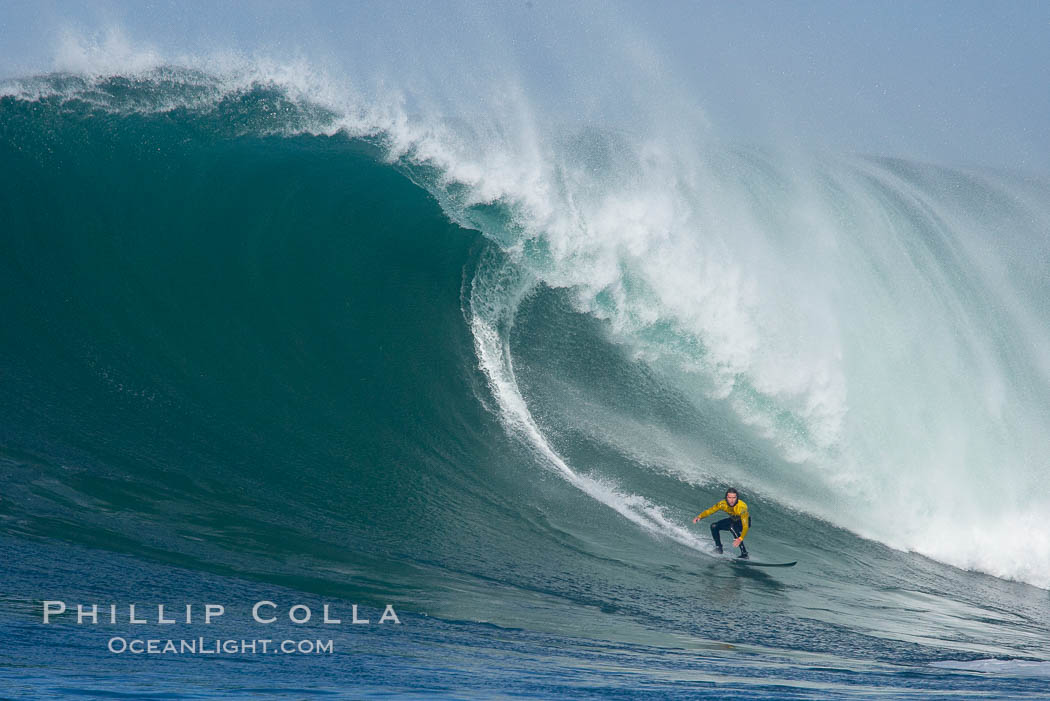 Grant Baker, champion, catches one of his many great waves of the day, this one in the first round.  Mavericks surf contest, February 7, 2006. Mavericks, Half Moon Bay, California, USA, natural history stock photograph, photo id 15312