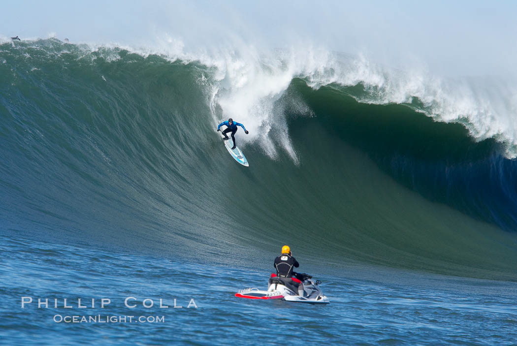 Grant Washburn (fifth place) gives the jetski photographer a show in the early rounds of the Mavericks surf contest, February 7, 2006. Half Moon Bay, California, USA, natural history stock photograph, photo id 15336