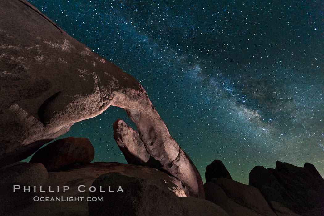 The Milky Way galaxy arcs over Arch Rock on a clear evening in Joshua Tree National Park. Joshua Tree National Park, California, USA, natural history stock photograph, photo id 26793