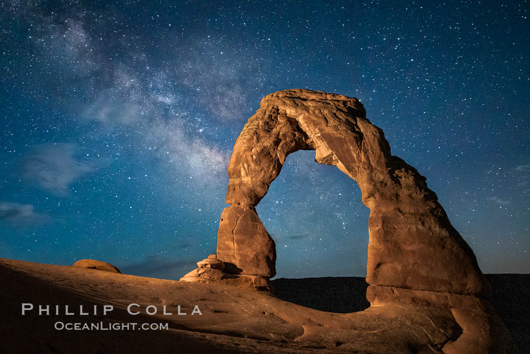 Milky Way arches over Delicate Arch, as stars cover the night sky. Arches National Park, Utah, USA, natural history stock photograph, photo id 27858