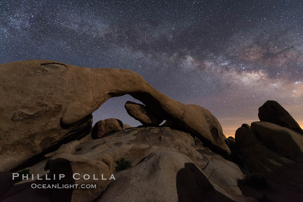 Image 30718, Milky Way during Full Lunar Eclipse over Arch Rock, Joshua Tree National Park, April 4 2015. Joshua Tree National Park, California, USA, Phillip Colla, all rights reserved worldwide. Keywords: arch, astrophotography, eclipse, evening, joshua tree national park, landscape astrophotography, lunar, lunar eclipse, milky way galaxy, moon, natural arch, night, stars.