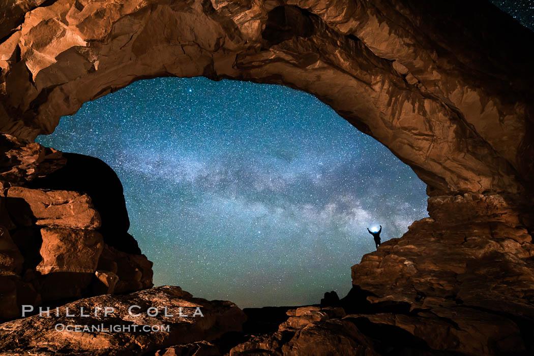 Hiker and Milky Way through North Window, Arches National Park. North Window, Arches National Park, Utah, USA, natural history stock photograph, photo id 29278