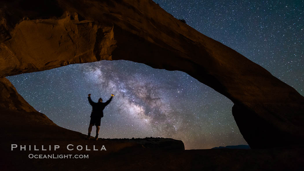 Image 29273, Milky Way and Stars through Wilson Arch. Moab, Utah, USA, Phillip Colla, all rights reserved worldwide. Keywords: arch, arches national park, astrophotography, astrophotography landscape, desert, evening, geologic features, landscape astrophotography, natural arch, night, outdoors, outside, rock, sandstone, scene, scenery, scenic, southwest, stars, utah, wilson arch.