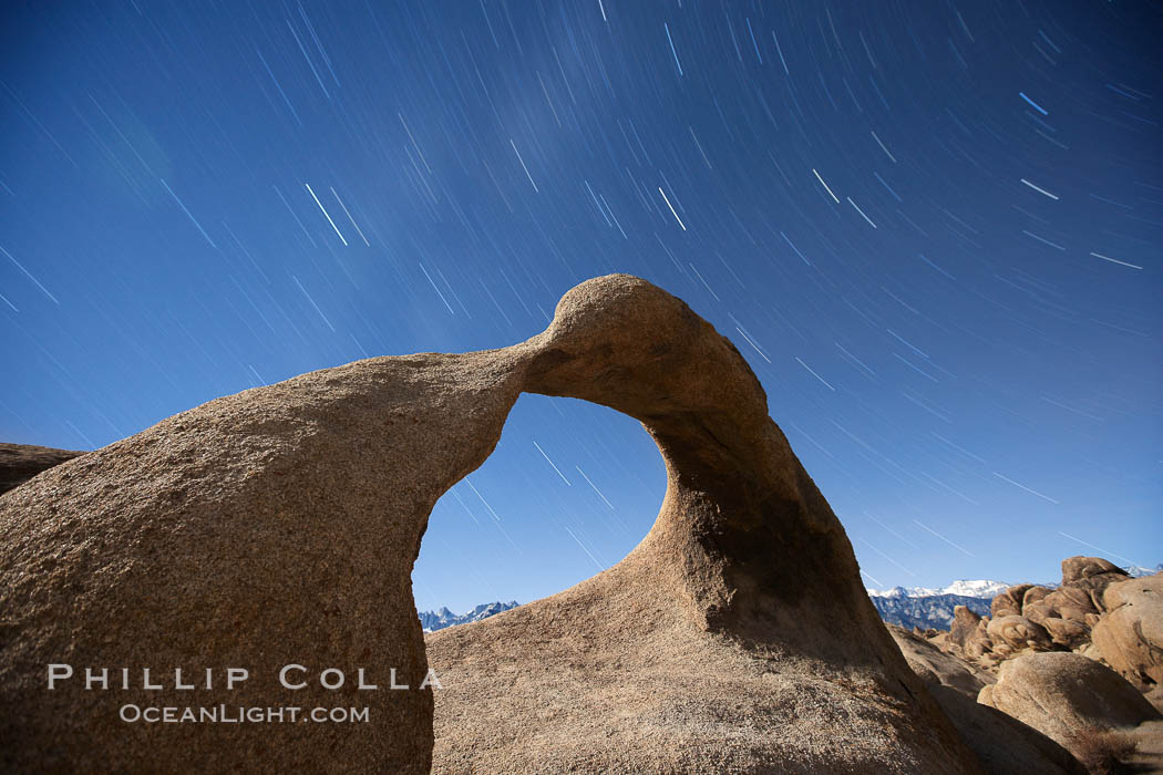 Mobius Arch in the Alabama Hills, seen here at night with swirling star trails formed in the sky above due to a long time exposure. Alabama Hills Recreational Area, California, USA, natural history stock photograph, photo id 21730