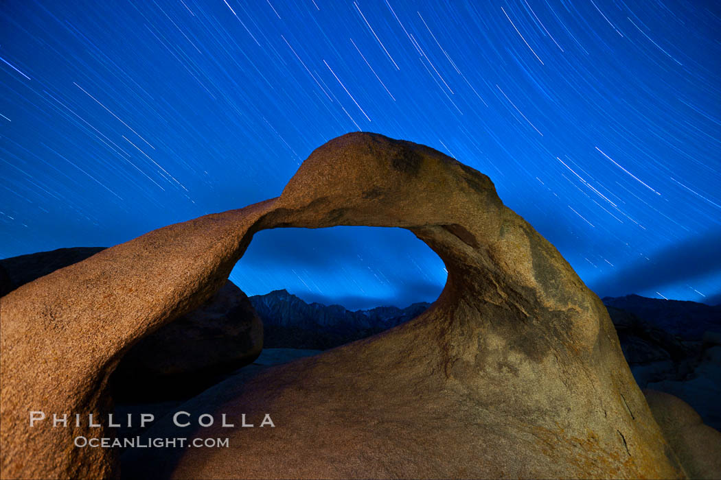 Mobius Arch in the Alabama Hills, seen here at night with swirling star trails formed in the sky above due to a long time exposure. Alabama Hills Recreational Area, California, USA, natural history stock photograph, photo id 27642