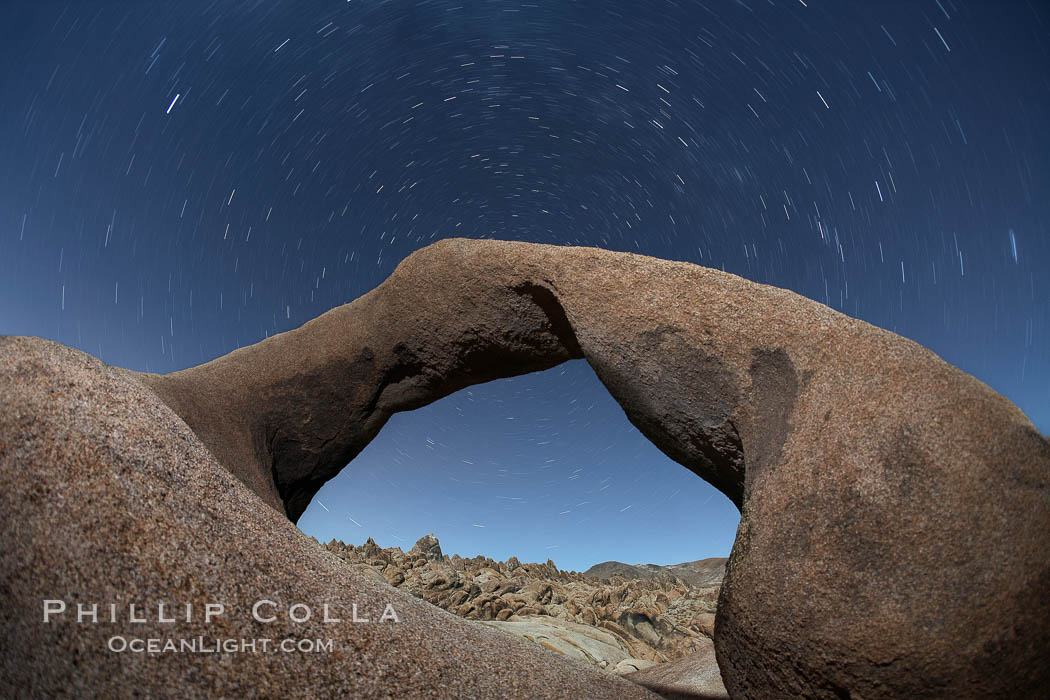 Mobius Arch in the Alabama Hills, seen here at night with swirling star trails formed in the sky above due to a long time exposure. Alabama Hills Recreational Area, California, USA, natural history stock photograph, photo id 21772