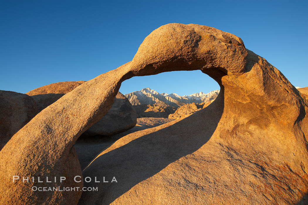 Mobius Arch in golden early morning light.  The natural stone arch is found in the scenic Alabama Hlls near Lone Pine, California. Alabama Hills Recreational Area, California, USA, natural history stock photograph, photo id 21731