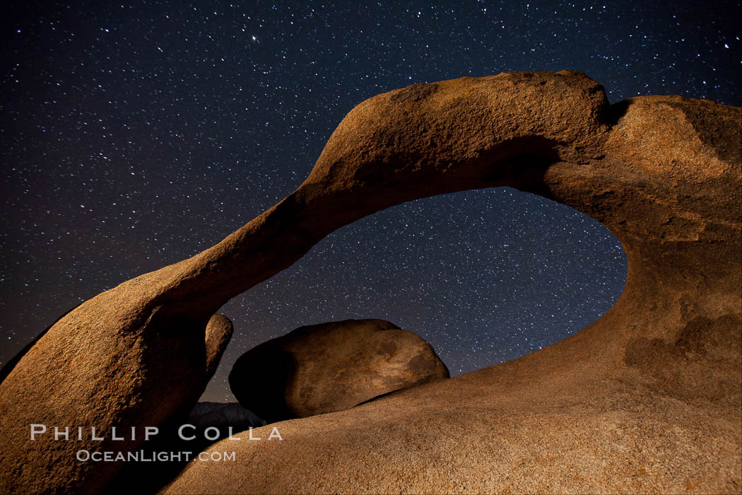 Mobius Arch in the Alabama Hills, seen here at night with swirling star trails formed in the sky above due to a long time exposure. Alabama Hills Recreational Area, California, USA, natural history stock photograph, photo id 27675