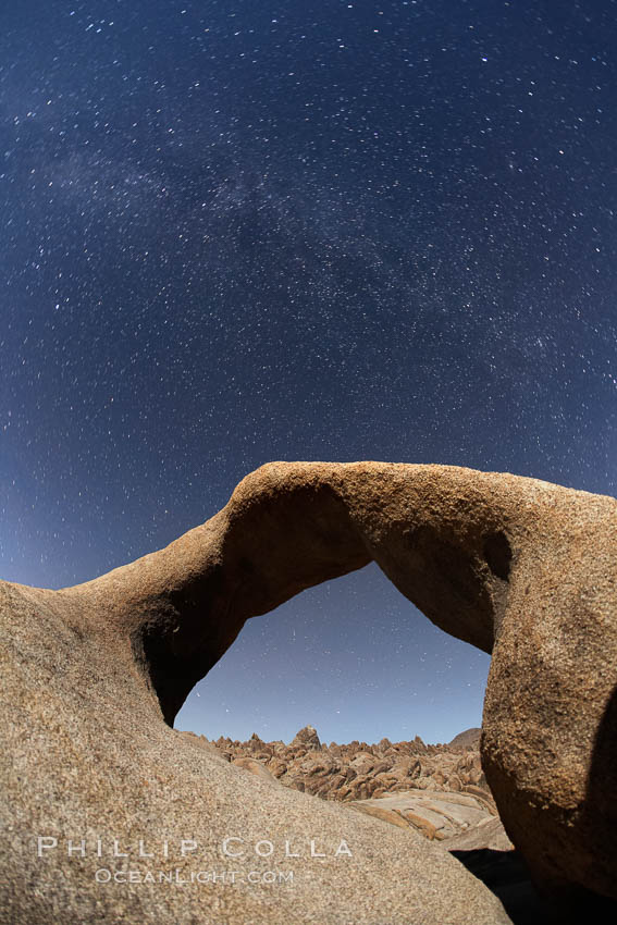 Image 21737, Mobius Arch with the Milky Way galaxy appearing in the night sky above. Alabama Hills Recreational Area, California, USA, Phillip Colla, all rights reserved worldwide. Keywords: alabama hills, alabama hills arch, alabama hills recreational area, arch, astrophotography, bureau of land management, california, environment, evening, galen arch, galen's arch, geologic features, geology, landscape, landscape astrophotography, lone pine, milky way, mobius arch, moebius arch, movie road arch, natural arch, natural arches, nature, night, night time exposure, outdoors, outside, scene, scenery, scenic, sky, star trail, star trails, stars, usa.