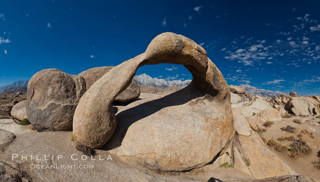 Mobius Arch panorama, with Mount Whitney (the tallest peak in the continental United States), Lone Pine Peak and Sierra Nevada Range framed within the arch. Mobius Arch is a 17-foot-wide natural rock arch in the scenic Alabama Hills Recreational Area near Lone Pine, California. Alabama Hills Recreational Area, California, USA, natural history stock photograph, photo id 26971