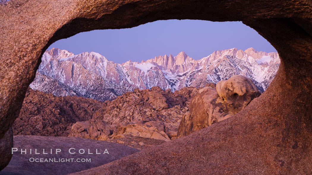 Mobius Arch at sunrise, framing snow dusted Lone Pine Peak and the Sierra Nevada Range in the background. Also known as Galen's Arch, Mobius Arch is found in the Alabama Hills Recreational Area near Lone Pine. California, USA, natural history stock photograph, photo id 27628