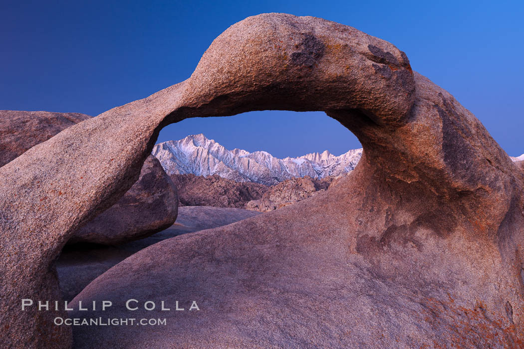 Mobius Arch at sunrise, framing snow dusted Lone Pine Peak and the Sierra Nevada Range in the background. Also known as Galen's Arch, Mobius Arch is found in the Alabama Hills Recreational Area near Lone Pine. California, USA, natural history stock photograph, photo id 27623