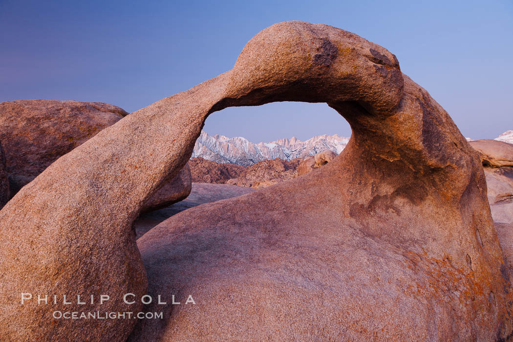 Mobius Arch at sunrise, framing snow dusted Lone Pine Peak and the Sierra Nevada Range in the background. Also known as Galen's Arch, Mobius Arch is found in the Alabama Hills Recreational Area near Lone Pine. Alabama Hills Recreational Area, California, USA, natural history stock photograph, photo id 27629