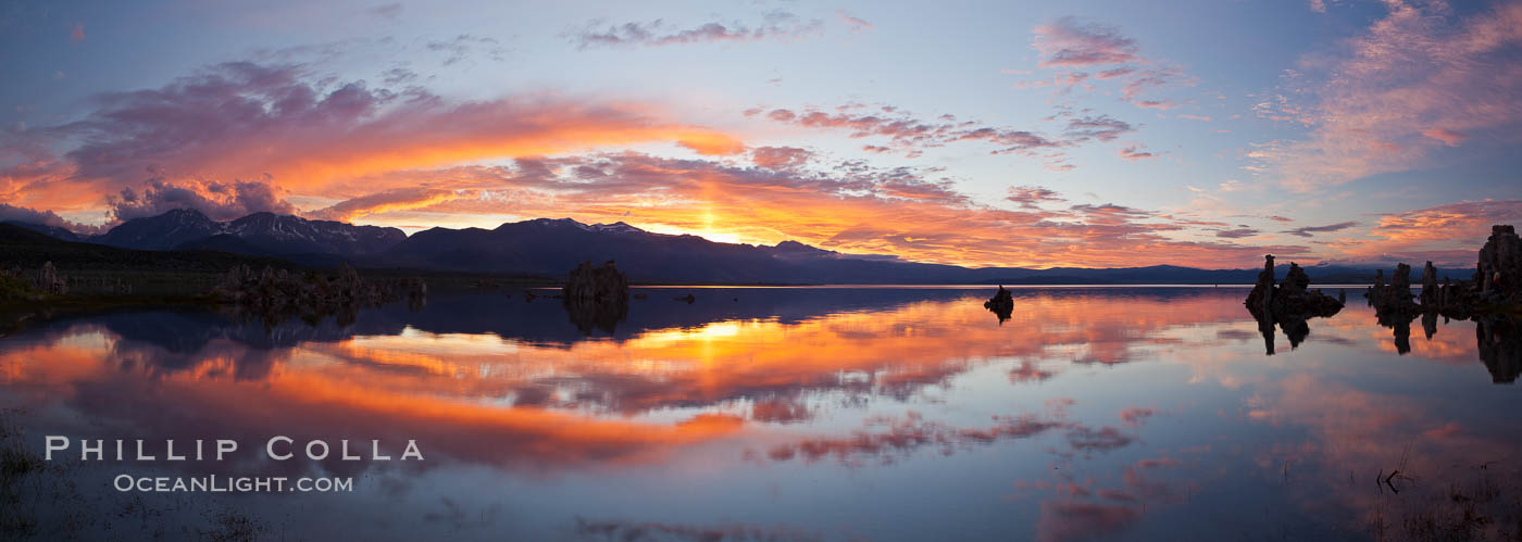 Sun pillar rises over the Sierra Nevada and this Mono Lake sunset, Sierra Nevada mountain range and tufas, clouds reflected in the still waters of Mono Lake. Mono Lake, California, USA, natural history stock photograph, photo id 26968