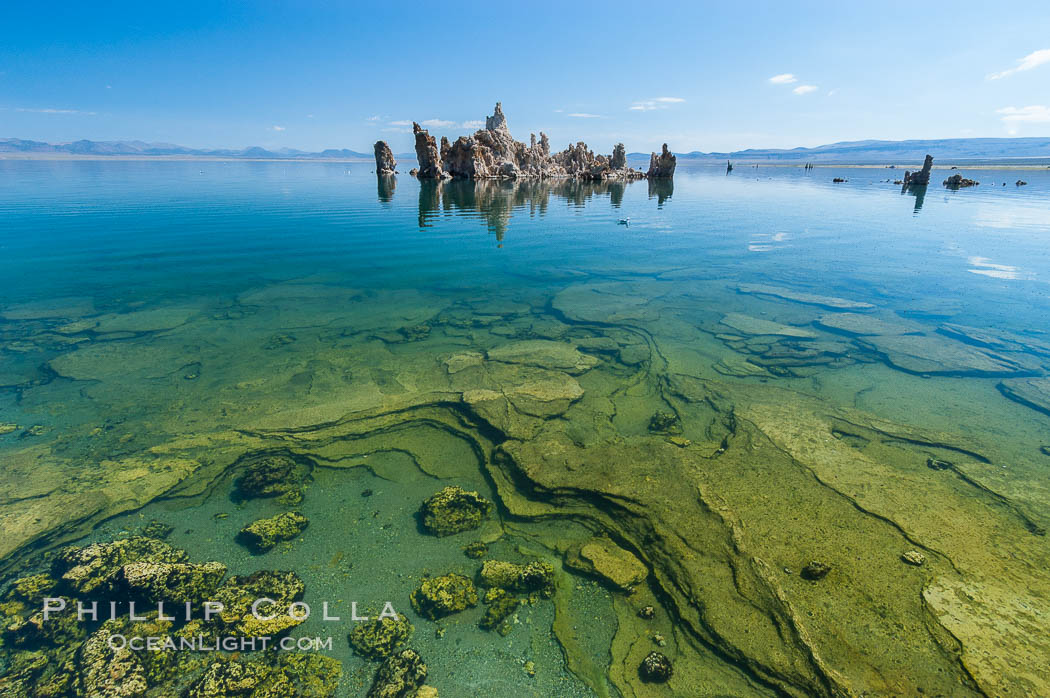 Tufa towers rise from Mono Lake.  Tufa towers are formed when underwater springs rich in calcium mix with lakewater rich in carbonates, forming calcium carbonate (limestone) structures below the surface of the lake.  The towers were eventually revealed when the water level in the lake was lowered starting in 1941.  South tufa grove, Navy Beach. California, USA, natural history stock photograph, photo id 09931