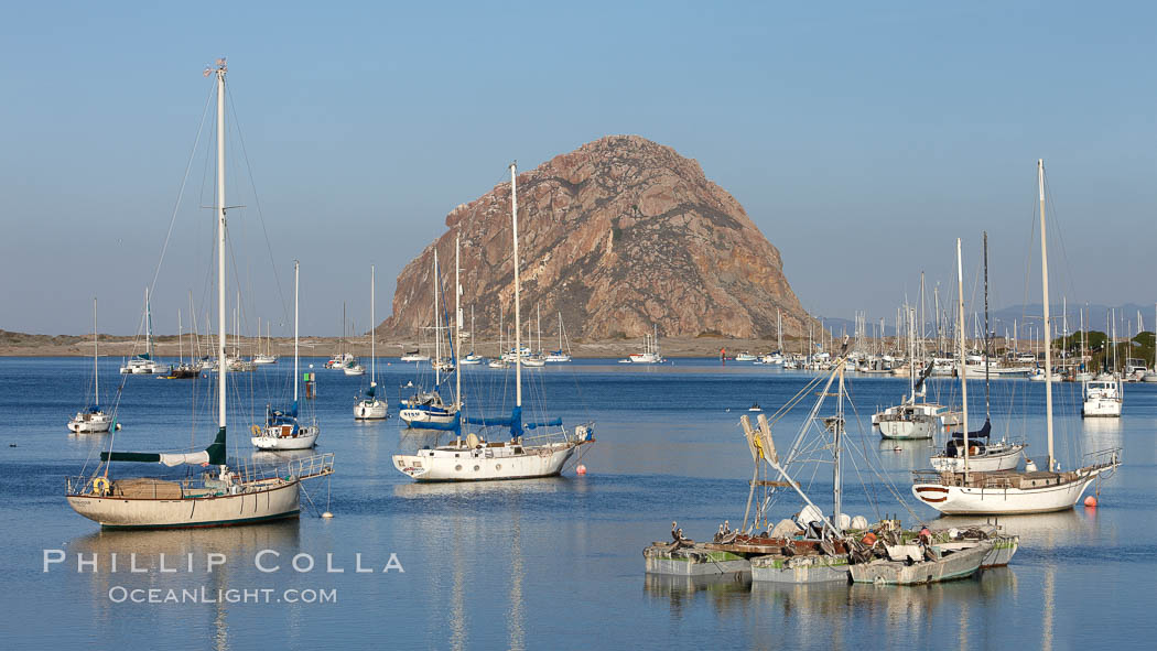 Morro Bay, boats and Morro Rock in the distance. California, USA, natural history stock photograph, photo id 22224