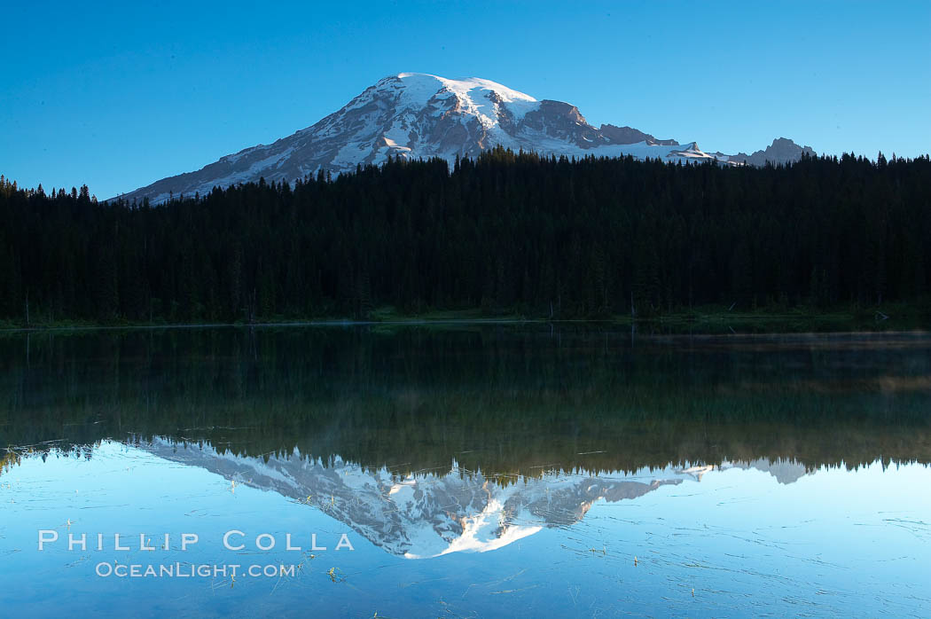 Image 13859, Mount Rainier is reflected in the calm waters of Reflection Lake, early morning. Reflection Lake, Mount Rainier National Park, Washington, USA, Phillip Colla, all rights reserved worldwide. Keywords: environment, landscape, mount rainier, mount rainier national park, mt rainier, national park, national parks, nature, outdoors, outside, rainier, reflection lake, scene, scenery, scenic, usa, washington.