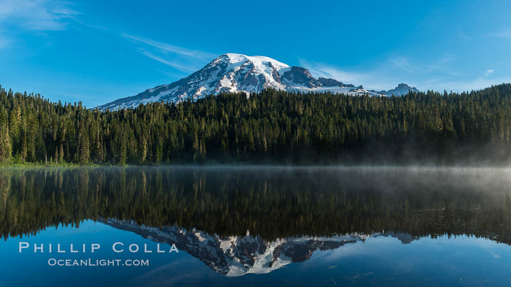 Mount Rainier is reflected in the calm waters of Reflection Lake, early morning. Reflection Lake, Mount Rainier National Park, Washington, USA, natural history stock photograph, photo id 28703