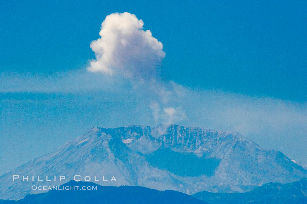 Mount St. Helens releases a burst of steam, viewed from Mount Rainier. Mount Rainier National Park, Washington, USA, natural history stock photograph, photo id 13926