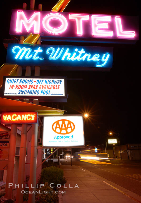 Mt. Whitney Hotel, near signs at night, Highway 395. Lone Pine, California, USA, natural history stock photograph, photo id 21763